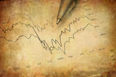 Stock Market Gains. Closeup of stock chart showing gains or regbound with pen Stock Image