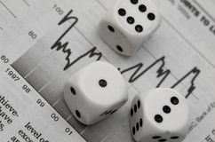 Stock Market Gamble. Stock Index graph (newwpaper) and three dice Stock Photo