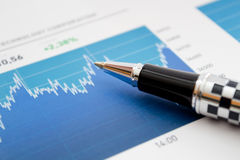 Stock market graph analyzing Royalty Free Stock Photo