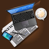 Stock market graph on laptop screen and mobile phone with newspa. Financial data on laptop screen and mobile phone with newspaper and coffee Royalty Free Stock Image