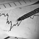 Stock market graph with a pen Royalty Free Stock Photography