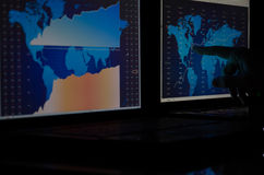 Stock market graph on monitors. Stock market graph on a two computer monitors Royalty Free Stock Photography