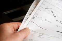 Financial graphs and charts analysis Royalty Free Stock Image
