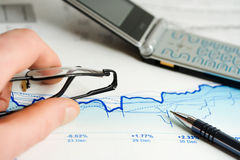 Stock market graphs analysis. Royalty Free Stock Images