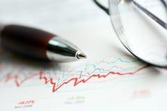 Stock market graphs analysis. Financial accounting stock market graphs and charts royalty free stock photography