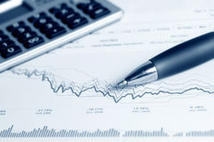 Financial graphs and charts analysis stock image