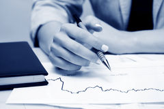 Stock market graphs analyzing. Royalty Free Stock Images