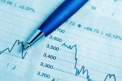 Stock market graphs and pen Royalty Free Stock Photos