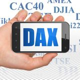 Stock market indexes concept: Hand Holding Smartphone with DAX on display. Stock market indexes concept: Hand Holding Smartphone with  blue text DAX on display Stock Images