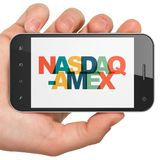 Stock market indexes concept: Hand Holding Smartphone with NASDAQ-AMEX on  display Stock Images