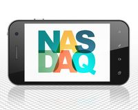 Stock market indexes concept: Smartphone with Nasdaq on display Royalty Free Stock Photos