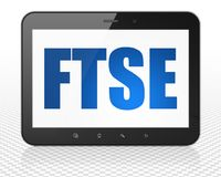 Stock market indexes concept: Tablet Pc Computer with FTSE on display. Stock market indexes concept: Tablet Pc Computer with blue text FTSE on display, 3D Royalty Free Stock Images