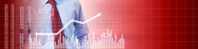 Stock market investing. Young stock market trader man over growing chart background Royalty Free Stock Photos