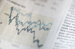 Stock market and newspaper Stock Photos