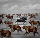 Stock Market Positive Forecast. Financial concept and contrarian individual financial symbol as a courageous bull running in the opposite direction of a group Royalty Free Stock Photography