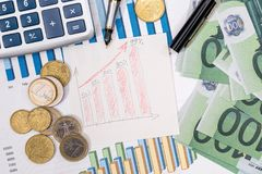 Stock market prices chart with euro bills Stock Image