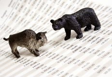 Stock market report. With bull and bear figure royalty free stock images