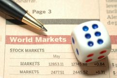 Stock Market Risk. Dice, pen and world stock market report Royalty Free Stock Photos
