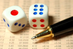 Stock Market Risk. Dice, pen and world stock market report Stock Photography