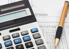 Stock market table analysis & research. Stock market table analysis, calculator and pen indicates research and analysis, horizontal orientation Stock Photography