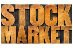 Stock market text in wood type Stock Photography