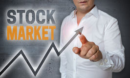 Stock market touchscreen is operated by man Royalty Free Stock Images