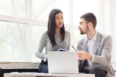 Stock market traders. Young banker explaining his co-worker new tendencies on stock market Stock Photography