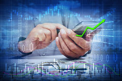 Investor man hands with calculator. Stock market trading man with calculator on green chart background Royalty Free Stock Photography