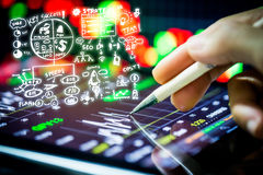 Stock market watching with digital tablet Stock Photos