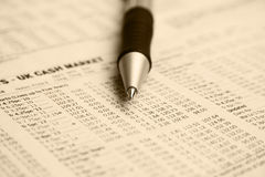 Stock markets. Close-up on pen on stock market report stock photo