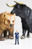 Stock markets. Business figurine placed with a bull and bear figurine Stock Image