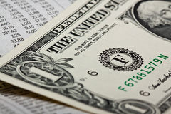 Stock and money. Newspaper with stock market informations Royalty Free Stock Images