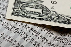Stock and money. Newspaper with stock market informations Royalty Free Stock Photo