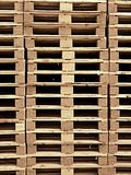 Stock of new wooden euro palletes ready for using. Stock Piles of wooden pallets in a yard ready for breaking up and recycling into firewood or kindling Stock Images