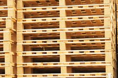 Stock of new wooden euro pallets at transportation company. Royalty Free Stock Photography