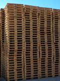 Stock of new wooden euro pallets at transportation company,. Stocked pallets Stock Photos