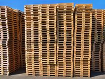 Stock of new wooden euro pallets at transportation company,. Stocked pallets Royalty Free Stock Photos