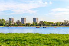 Stock Newington West Reservoir, Hackney, London. Spring view of Stock Newington West Reservoir, Hackney, London with green grass, blue sky and a few floating royalty free stock photo