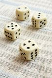 Stock numbers and cubes 1. Close up of stock market numbers in papers and dice royalty free stock photos