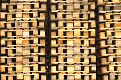 Stock of old wooden euro pallets at transportation company. Stock Photo