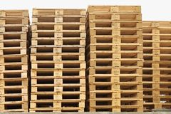 Stock of old wooden euro pallets at transportation company. Royalty Free Stock Images