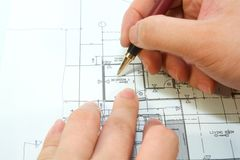Stock photo architects are re-designing a bedroom blueprint Stock Image