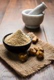 Stock Photo of Asafoetida powder / Hing or Heeng with cake and mortar Stock Photography