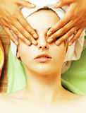 Stock photo attractive lady getting spa treatment in salon, close up asian hands on face Royalty Free Stock Photos