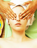 Stock photo attractive lady getting spa treatment in salon, close up asian hands on face Royalty Free Stock Photo