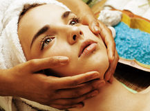Stock photo attractive lady getting spa treatment in salon, close up asian hands on face Royalty Free Stock Photography