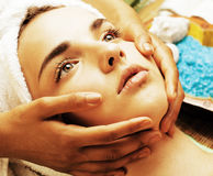 Stock photo attractive lady getting spa treatment in salon, close up asian hands on face Stock Photos