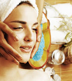 Stock photo attractive lady getting spa treatment in salon, close up asian tan hands on face Stock Photo