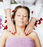 Stock photo attractive lady getting spa treatment in salon, massage doctor smiling care pretty Royalty Free Stock Images