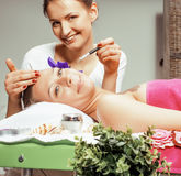 Stock photo attractive lady getting spa treatment in salon, massage doctor smiling care pretty Stock Photos